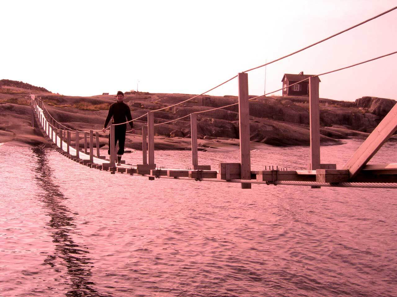 bridge over a river with red tint