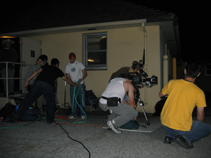 crew outside at night with camera