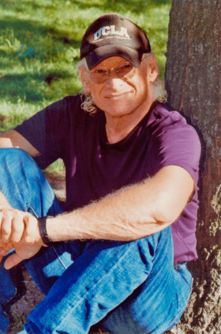 Screenwriter Richard Walter sitting by a tree