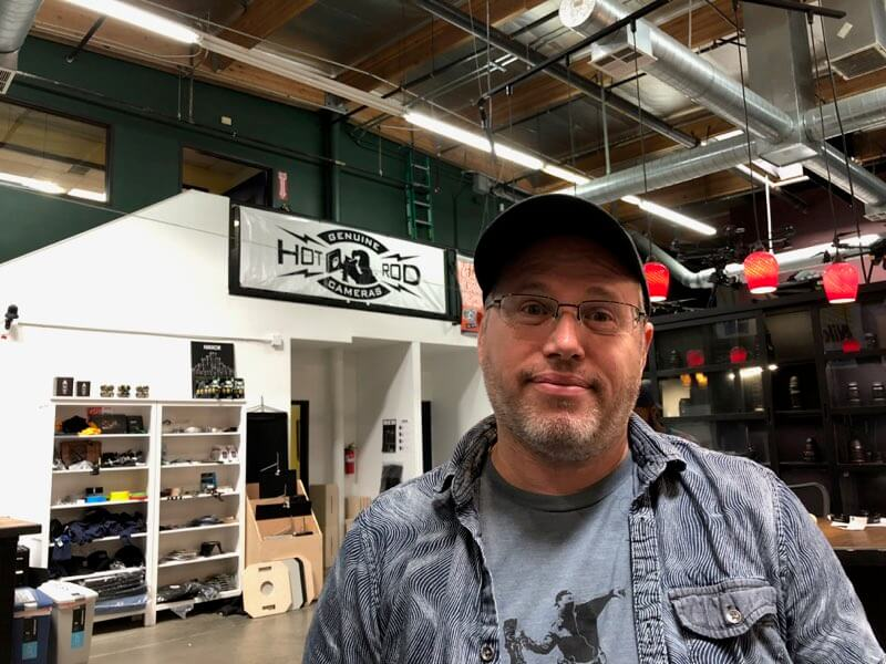 illya friedman standing in his camera shop Hot Rod Cameras